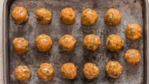 meatballs arranged on baking tray