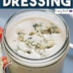 creamy homemade blue cheese dressing in jar with text overlay