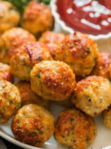 oven baked chicken meatballs served in plate with ketchup