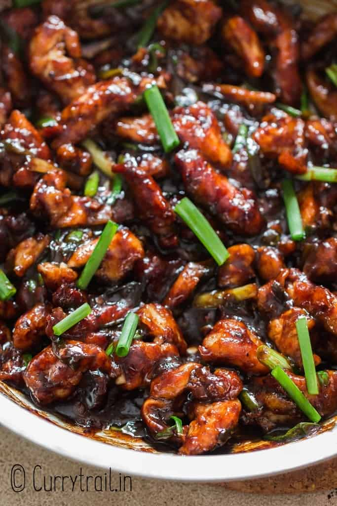 close up view of Mongolian chicken cooked in skillet