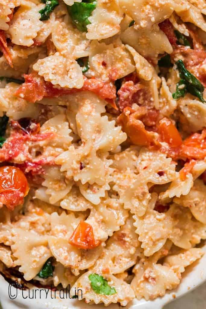 close up feta cheese and cherry tomato pasta