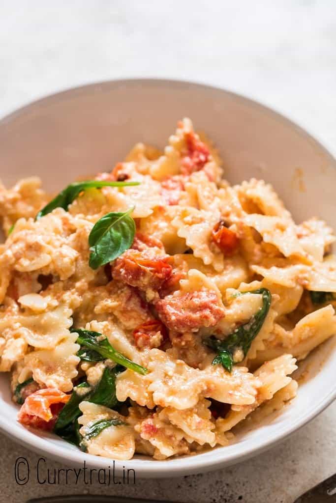 bowl of feta cheese and cherry tomato pasta