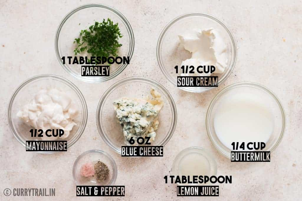 all ingredients for homemade blue cheese dressing placed on white board