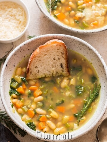 two bowls of bean soup with kale