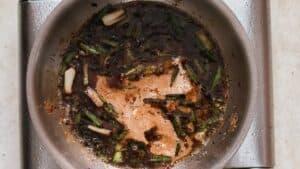 Mongolian chicken sauce in skillet