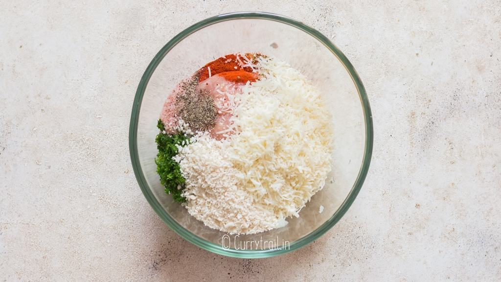 all ingredients for baked chicken meatballs in mixing bowl