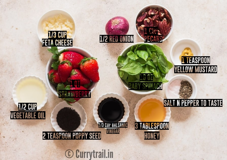 all ingredients for strawberry spinach salad on board