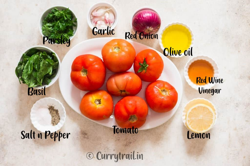 all ingredients for marinated tomatoes on white board