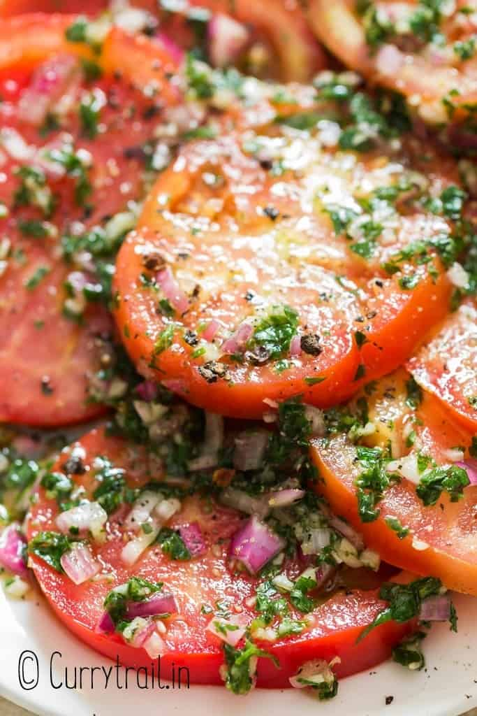close up of marinated tomato salad on plate
