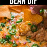refried bean dip cooked in cast iron skillet with text overlay