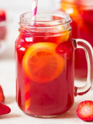 southern sweet tea with strawberries in 2 jars