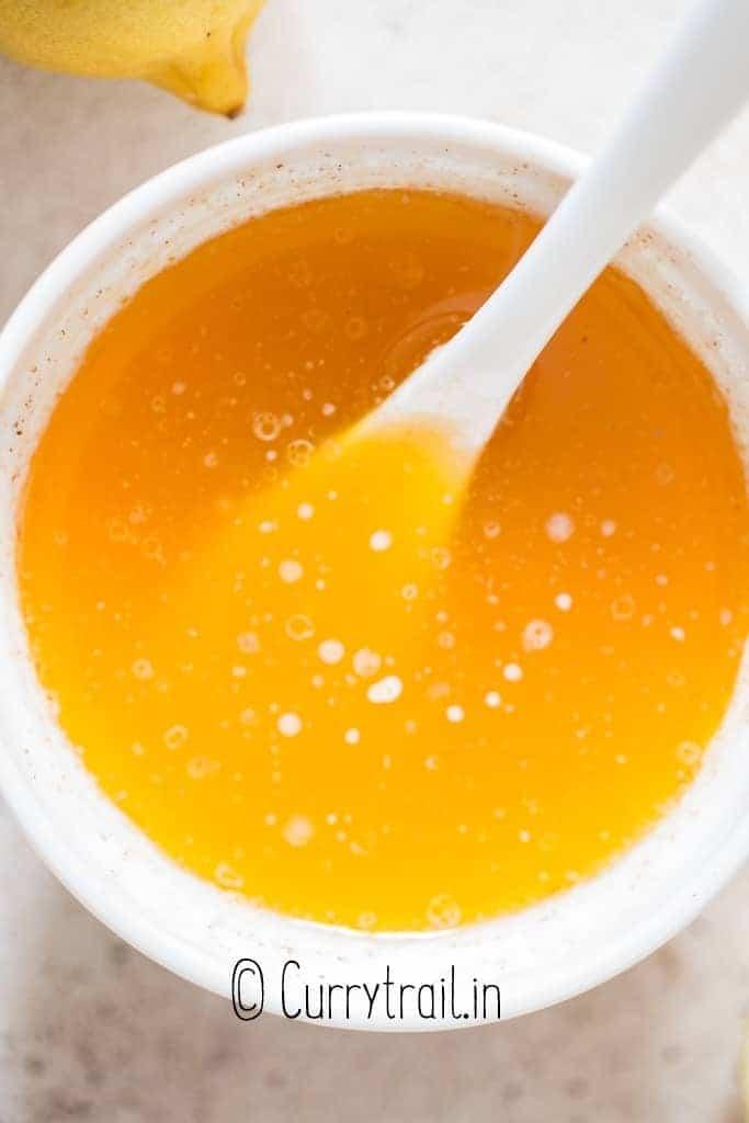 small bowl of rich lemon butter sauce