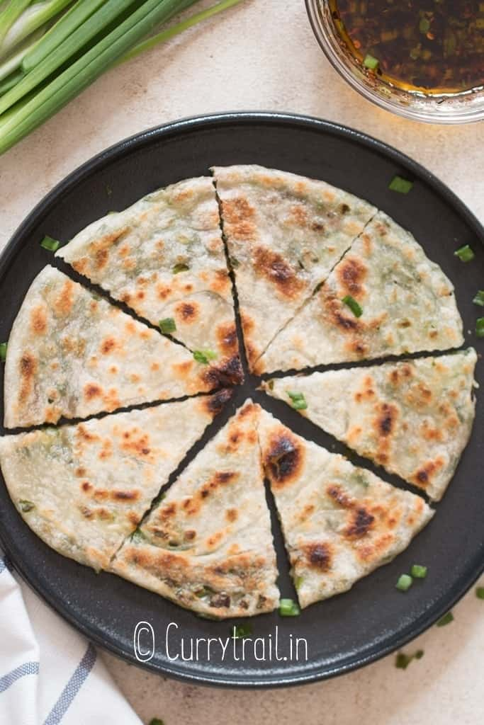 Chinese scallion pancakes cut into triangles with dipping sauce