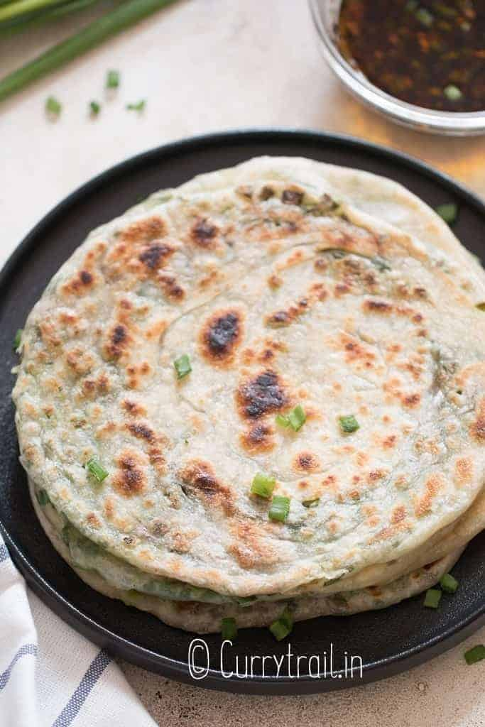 green onion pancakes stacked on each other