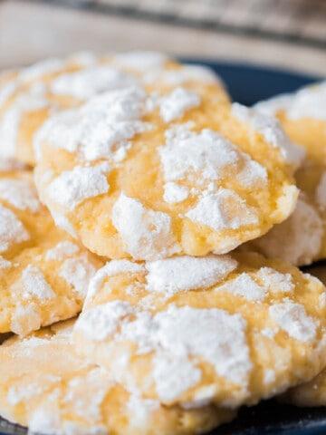 lemon crinkle cookies stacked on plate