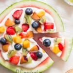 watermelon dessert pizza with cheesecake frosting and fruits