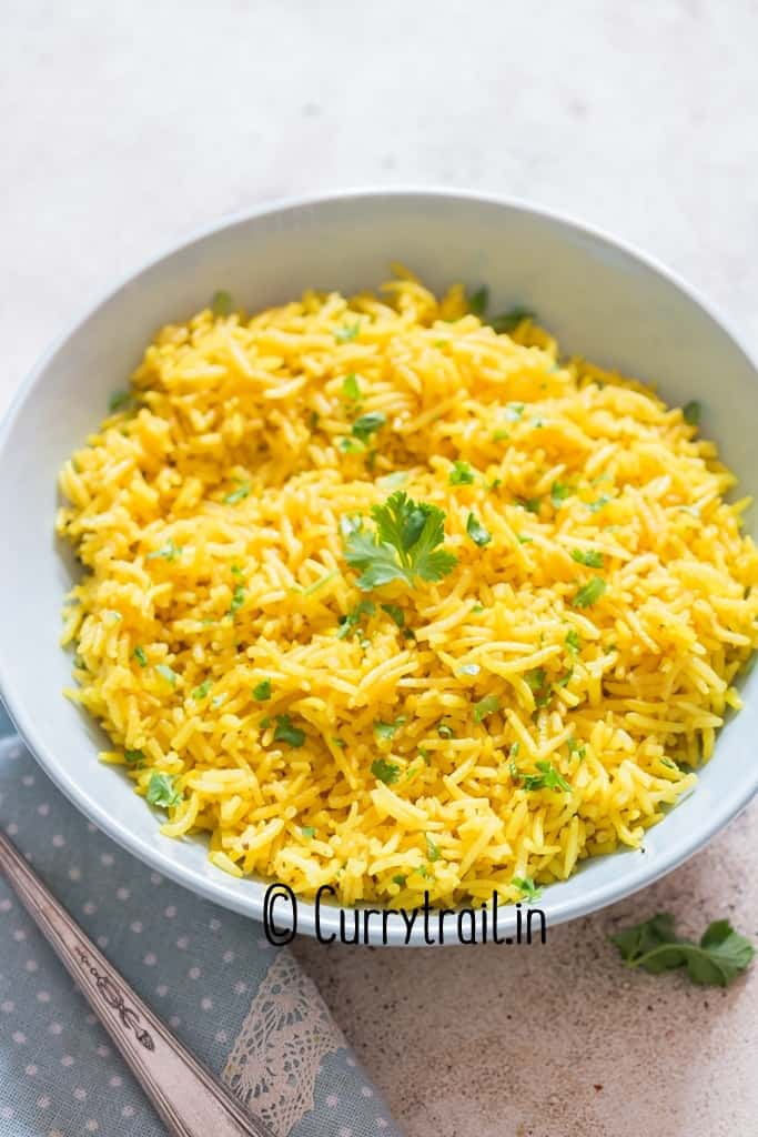 bright yellow turmeric rice in bowl