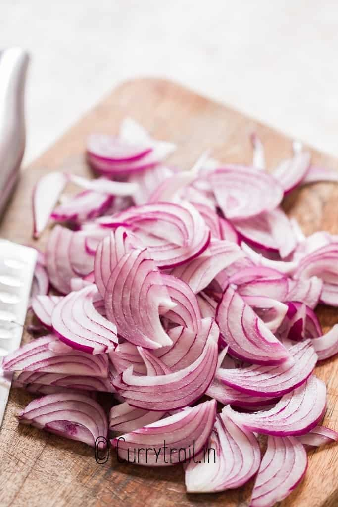 sliced red onion on cutting board