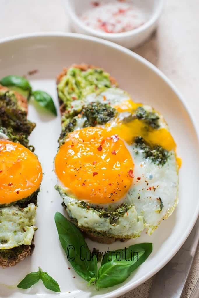 close up view of pesto egg avocado toast