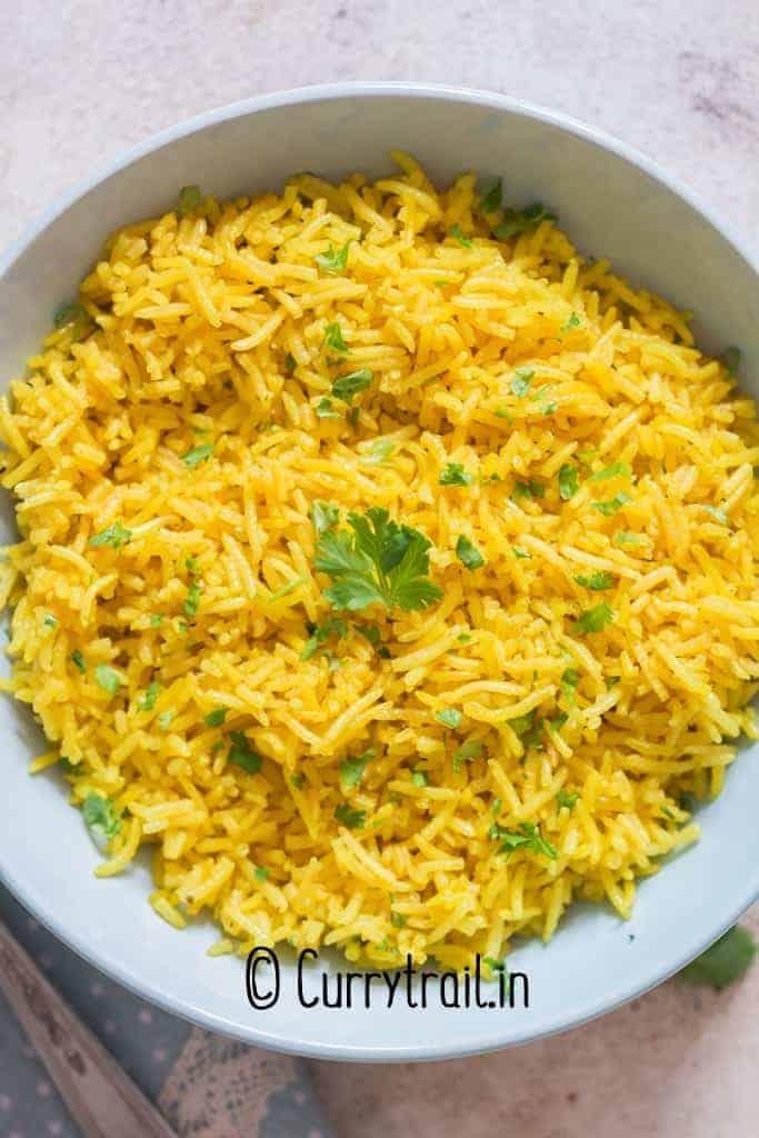 yellow rice in ceramic bowl