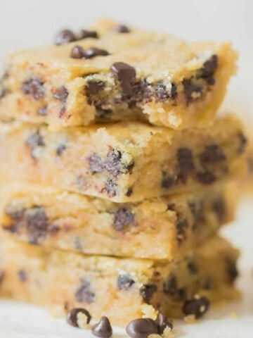 cookie bars with chocolate chips stacked up