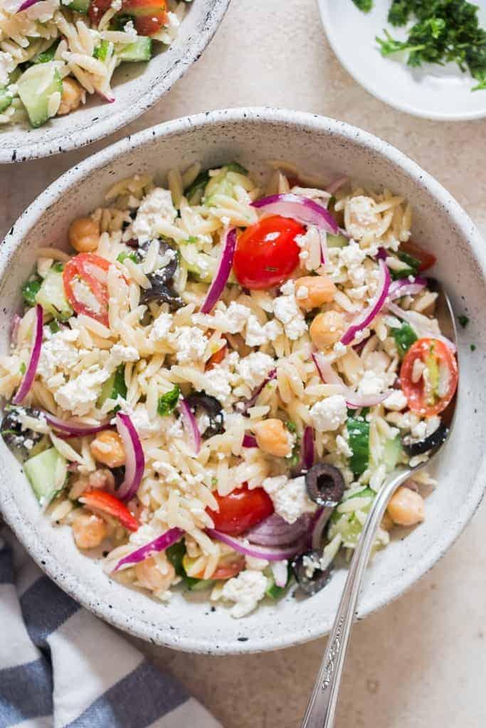 pasta salad made using orzo pasta and feta cheese