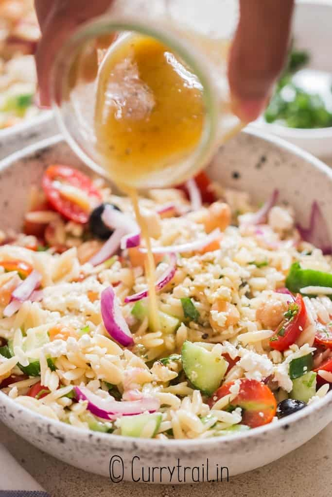 pasta salad with Greek salad dressing drizzled on top
