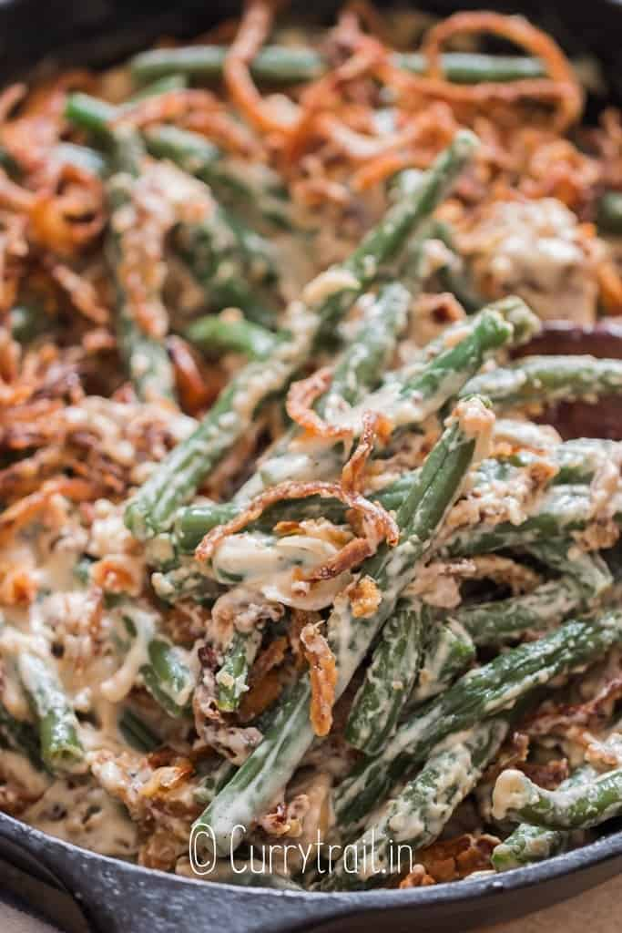 close up view of easy green bean casserole cooked in skillet