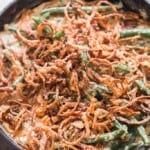 green beans cooked in creamy gravy with crispy onions on top