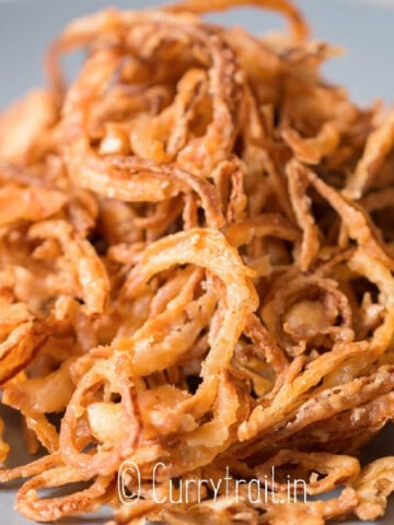 fried onions on plate