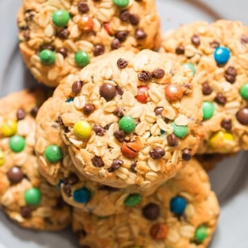 giant M&M studded monster cookies on plate