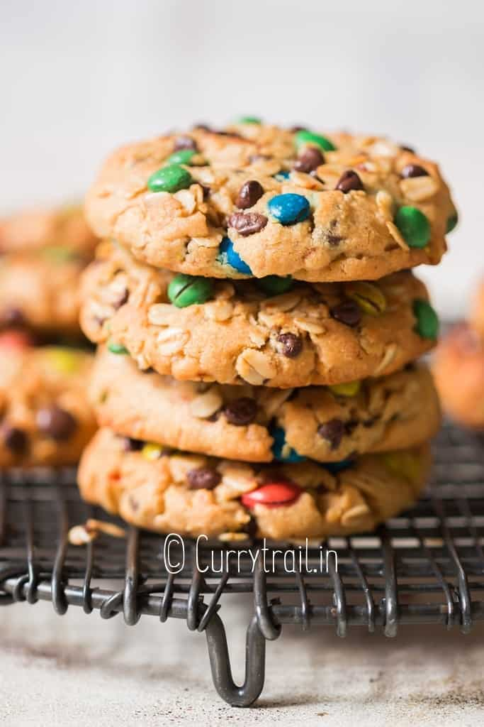cookie stacked up on one another studded with M&Ms chocolate chips