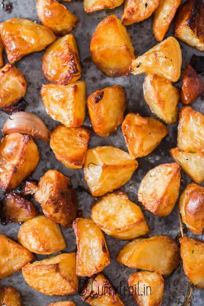 close up view of roast potatoes in baking dish