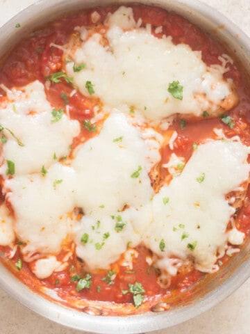 chicken with mozzarella in skillet