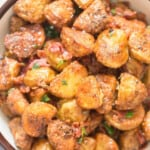 crispy parmesan crusted roasted potatoes with crispy bacon on top